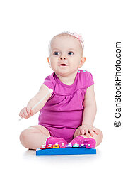 cute girl baby playing with musical toy