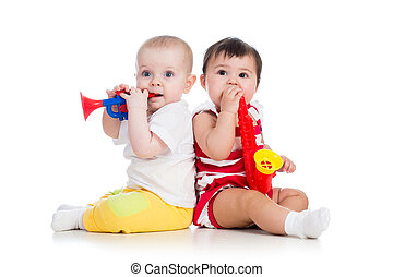 Funny babies girls with musical toys Isolated on white...