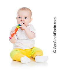 Funny baby girl playing with musical toy Isolated on white...