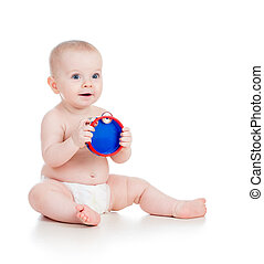 Baby playing with musical toy. Isolated on white background