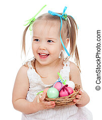 cute smiling baby girl holding Easter eggs in basket isolated on white background
