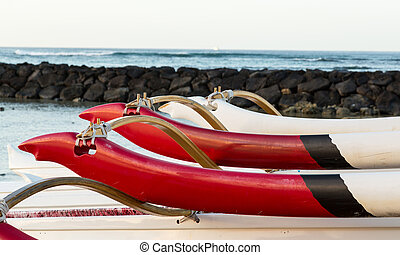 Sunrise over hawaiian canoes from Waikiki Hawaii