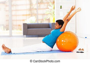 pregnant woman exercising - pregnant african american woman...