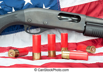 Shotgun on flag - A pump action shotgun with several shells...