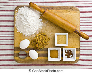 ingredients with a rolling pin on a kitchen tabletop - View...