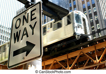 One Way - The El train in Chicago with a one way sign.