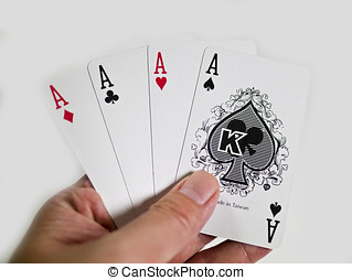 pokers of playinf cards - A winning poker hand of four aces...