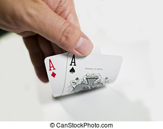 pokers of playinf cards - two aces on hands on white...