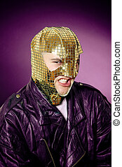 Queer hero - Man wearing gold mask and leather jacket