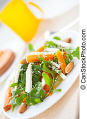 delicious salad with pumpkin and greens, closeup