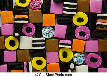 Liquorice allsorts fill frame - A shot from above of stacked...