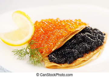 flapjack with caviar - thin pancakes with red and black...