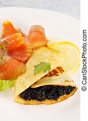 flapjack, caviar and salmon - ruddy flapjack with caviar and...