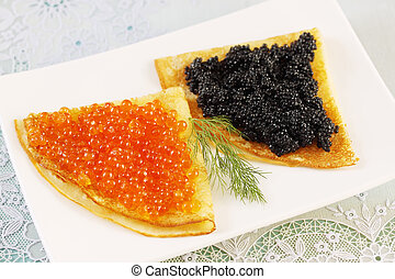 pancakes with dill - thin pancakes with red and black caviar