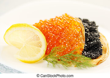 pancakes with lemon - thin pancakes with red and black...