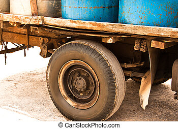 Old truck. - Old truck and a plastic bucket on the back of...