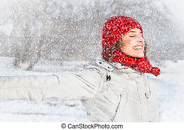 Happy young woman on the snow  day. Winter concept.