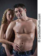 Topless couple in denim - Portrait of half nacked couple in...