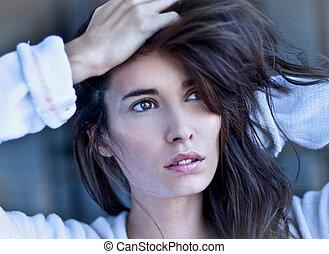 Glamorous woman posing . Art portrait.