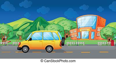 A yellow van at the road
