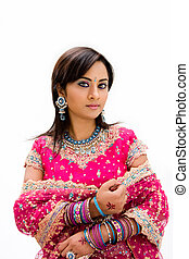 Beautiful Bangali bride in colorful dress, isolated