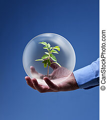 Environmental friendly business concept - businessman hand...