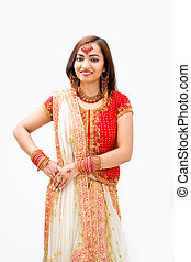 Beautiful Bengali bride in colorful dress, isolated