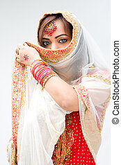 Woman with veil - Elegant Bengali bride with veil in front...