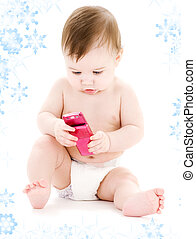 baby with cell phone - picture of baby boy in diaper with...