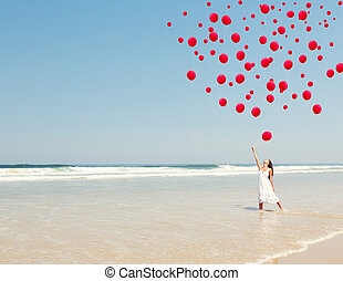 Dropping ballons in the sky - Beautiful girl in the beach...
