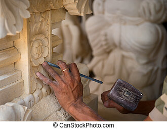 Stone carving at process - Stone mason at work carving an...