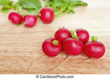 Eight radishes - A bunch of organic garden radishes on a...