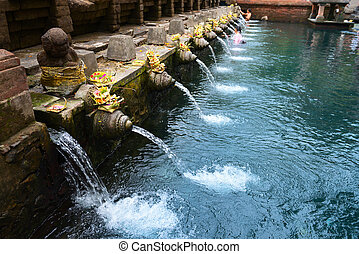 Balinese holy springs in Tirta Empul temple - Holy spring...