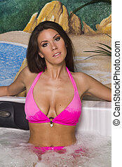Big breasted brunette woman in the jacuzzi