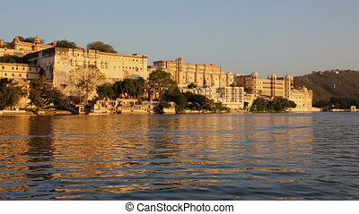 night follows day - palace on lake in Udaipur India