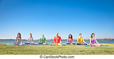 Group of young people have meditation on yoga class .Yoga...