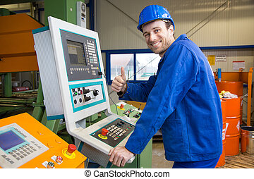 Construction worker operating a machine - Construction...