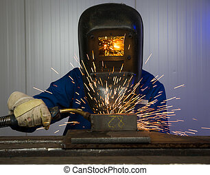 Man welding steel creating many sparks