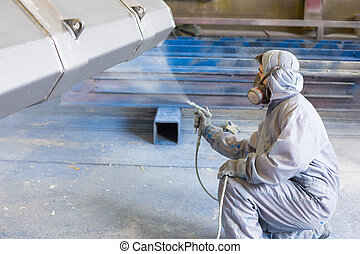 vehicle painter spraying color on construction bucket -...