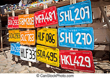 Traditional handcrafted vehicle registration plates like...
