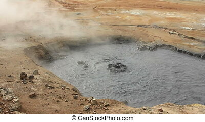 Mud fumarole 4 - Boiling and steaming mud fumarole on the...