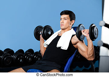 Bodybuilder exercises with weights