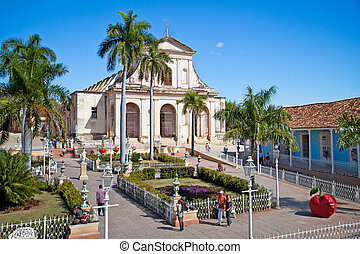 Tourists admire typical architecture in Trinidad, Cuba -...