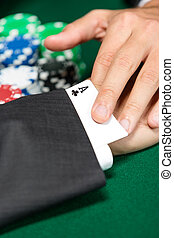 Poker player cheats with card from the sleeve Risky...