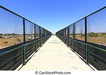 perspective in the passage of a bridge with fences