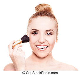 woman with a brush - portrait of a beautiful woman applying...