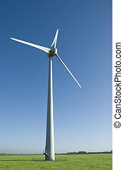 Wind turbine in a field