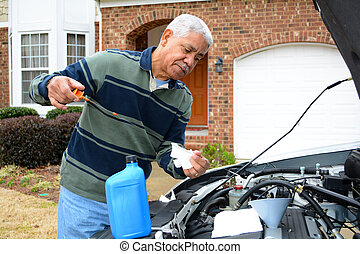Mechanic Working On Car - Mechanic working on a car in his...
