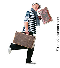 Happy running traveler with vintage suitcases - Happy...