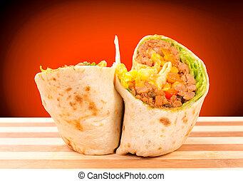 Half of burrito - Burrito on the wooden board